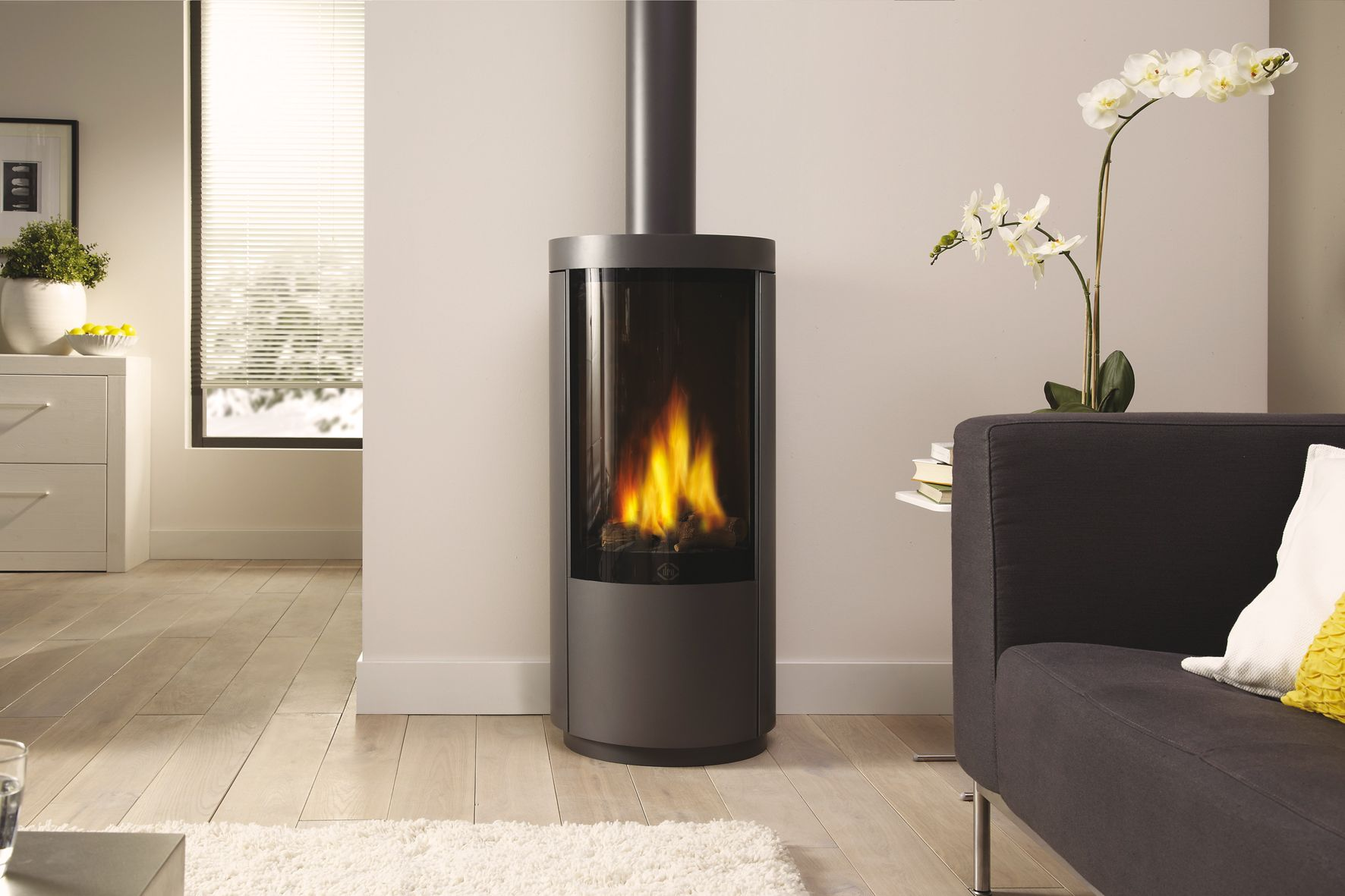 the circo is a freestanding dru gas stove with a unique curved