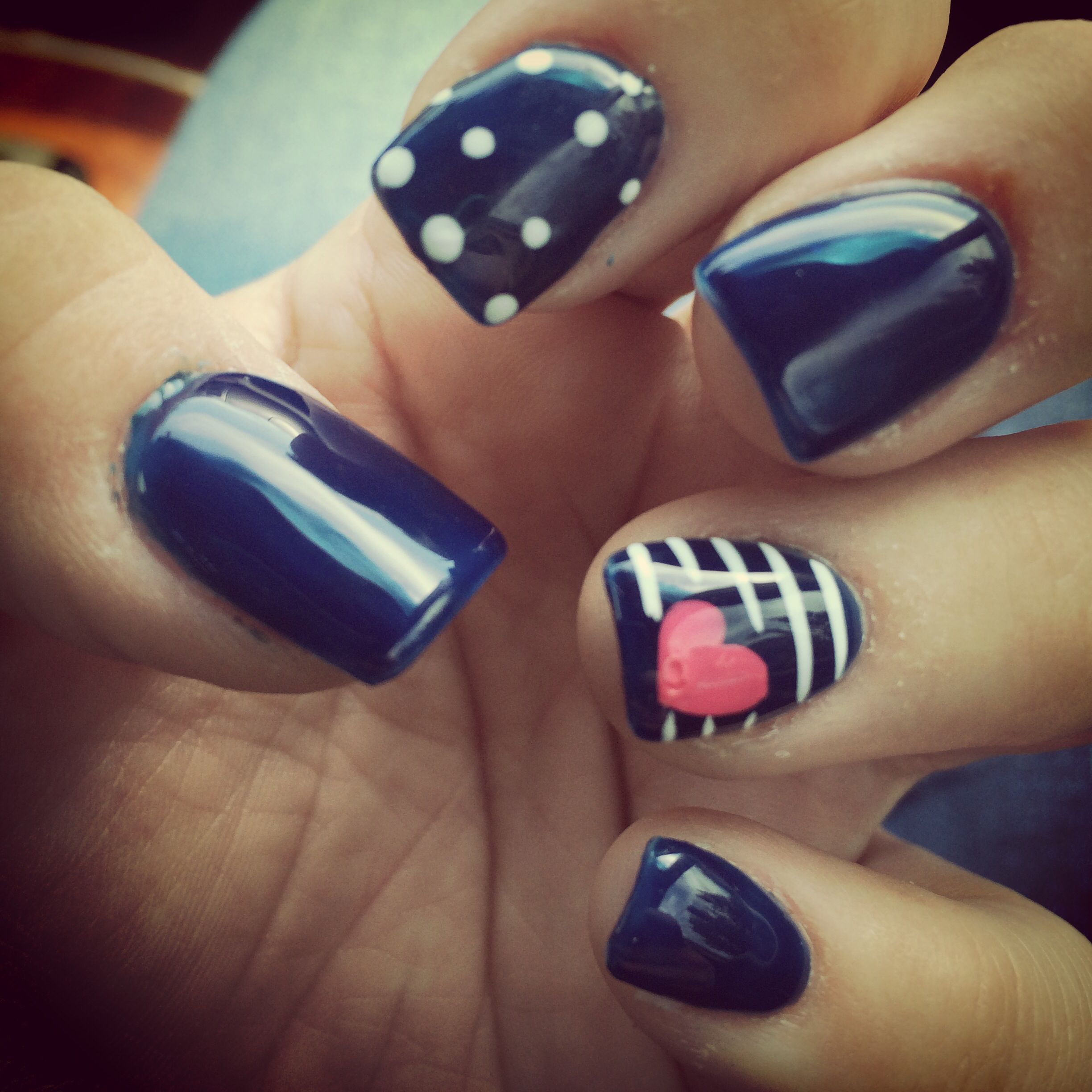 Navy blue white stripes with a cute pink heart nail design ...