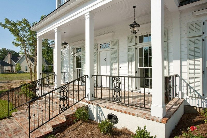 Black Metal Railing In Vertical Lines And Ornamental Of Railing To Beautify Your Front Porch Porch Railing Designs Exterior Brick House With Porch