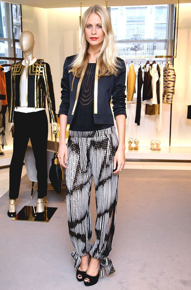 Print pants with heels and a plain black top