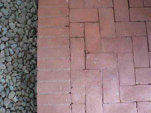 Herringbone Pattern Brick Paver Patio With Edge And Gravel