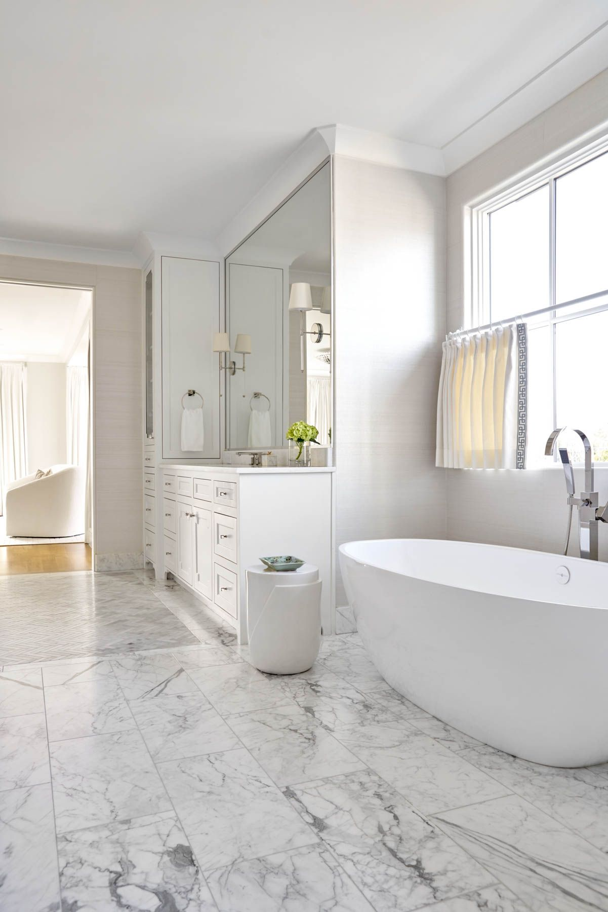 White stand alone tub and marble flooring | Jenkins Interiors ...