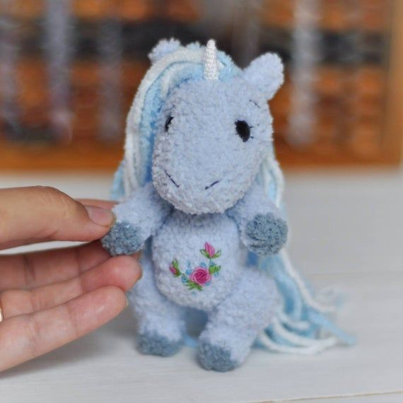 Mini amigurumi Unicorn Crocheted Unicorn Miniature Toy Blythe animal friend Dollhouse accessories Miniature Plush Unicorn toy Photo prop #miniaturetoys This Tiny Unicorn want to be your friend. He is hand-crocheted from softy yarn  and stuffed with non-allergic holofiber. Little Unicorn will arrive to you packed in a gift-bag.  Unicorn is about 12 cm tall = 4.7 inches You can move his arms and legs. Very cute addition to your dollhouse and a nice gift for doll's and miniature's collectors or any #dollhouseaccessories