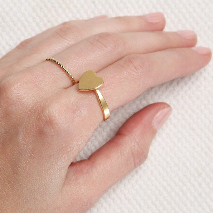 The perfect heart ring Made of high quality 14K gold plating over brass base.. This ring is great alone or with others, perfect for everyday look. Just choose your size- Please feel free to contact me for any questions. The jewelry comes in a beautiful gift box with my brand logo- Just awaiting to be given away.