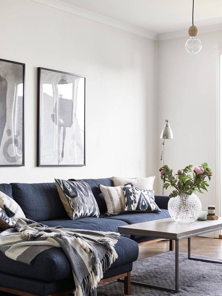 Modern Living Room Design With Modern Navy Sofa And Boho Pillows Modern Blue And White Living R Blue Couch Living Room Blue Sofas Living Room Blue Sofa Living