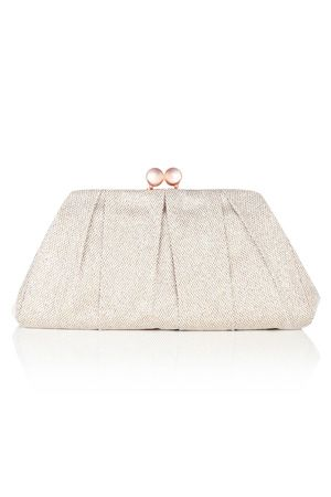 This metallic finish oversized clutch bag has a big bobble fastening to the top and a silky lining inside.