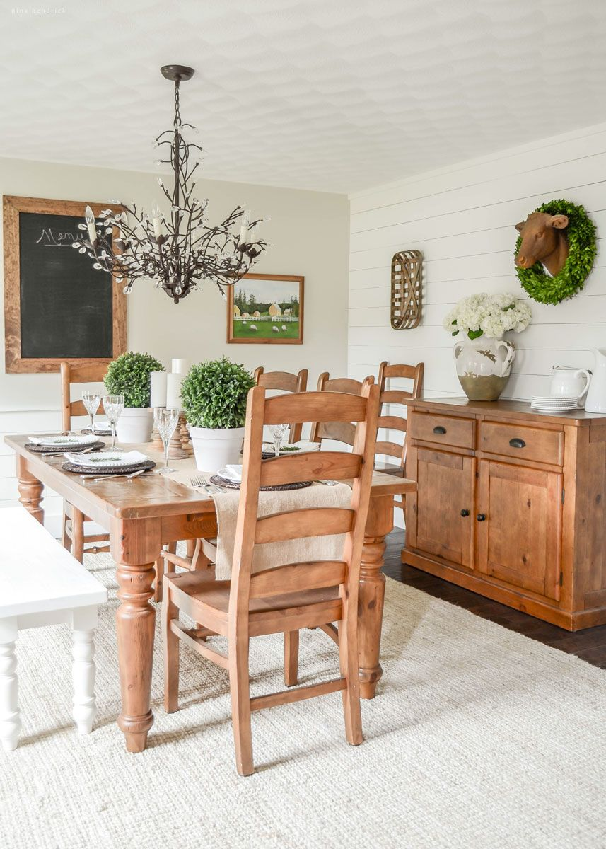 See how one blogger transformed her dull and dated space to a shiplap-covered farmhouse dining room!