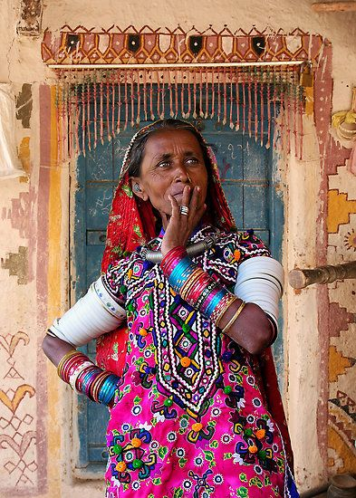 TRIBAL LADY - KUTCH by Michael Sheridan. A Meghwal Lady – Kutch. Kutch is remote desert area located in far Western Gujarat State – India. A number of tribal groups live in the area. The tribal ladies of Kutch are well known for their elaborate embroidery which is most evident in their clothing. This attire is worn daily, not just on special occasions.   Clothroads