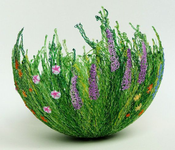 This bowl is made of embroidered thread! It is so neat! The artist makes all kinds of neat embroidered stuff like this.