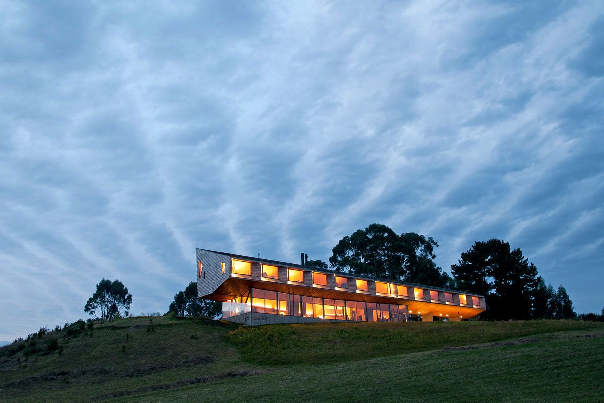 Inspired by Chiloé Island's diverse landscape, the firm Mobil Arquitectos devised a sculptural haven worthy of the rugged surroundings.    - ELLEDecor.com