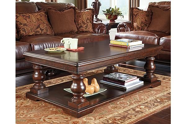 The Sutwick Coffee Table From Ashley Furniture Homestore Afhs Com