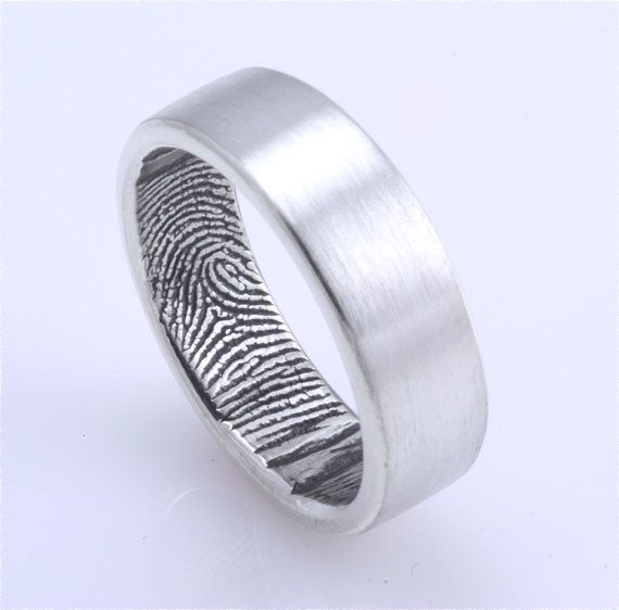 Custom finger print wedding band. The finger print of your loved one is imprinted around the inside of the ring