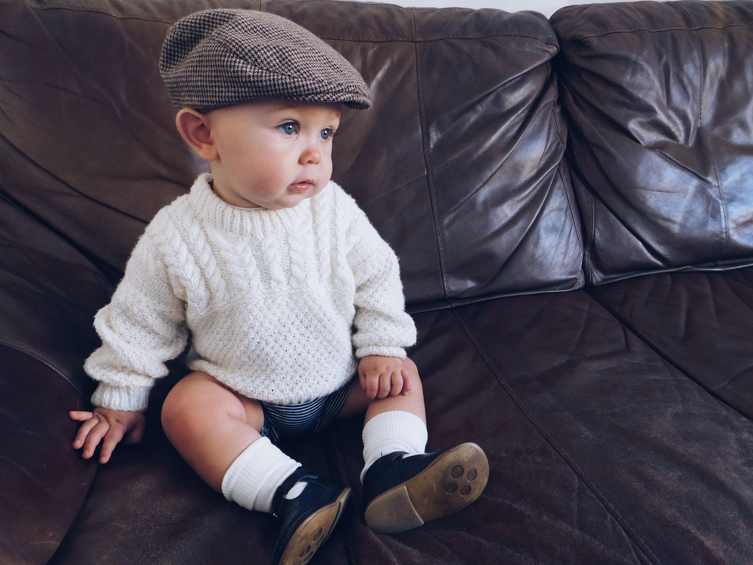 Photo of Traditional baby clothes, baby boy, knitted jumper, old fashioned baby clothes, …