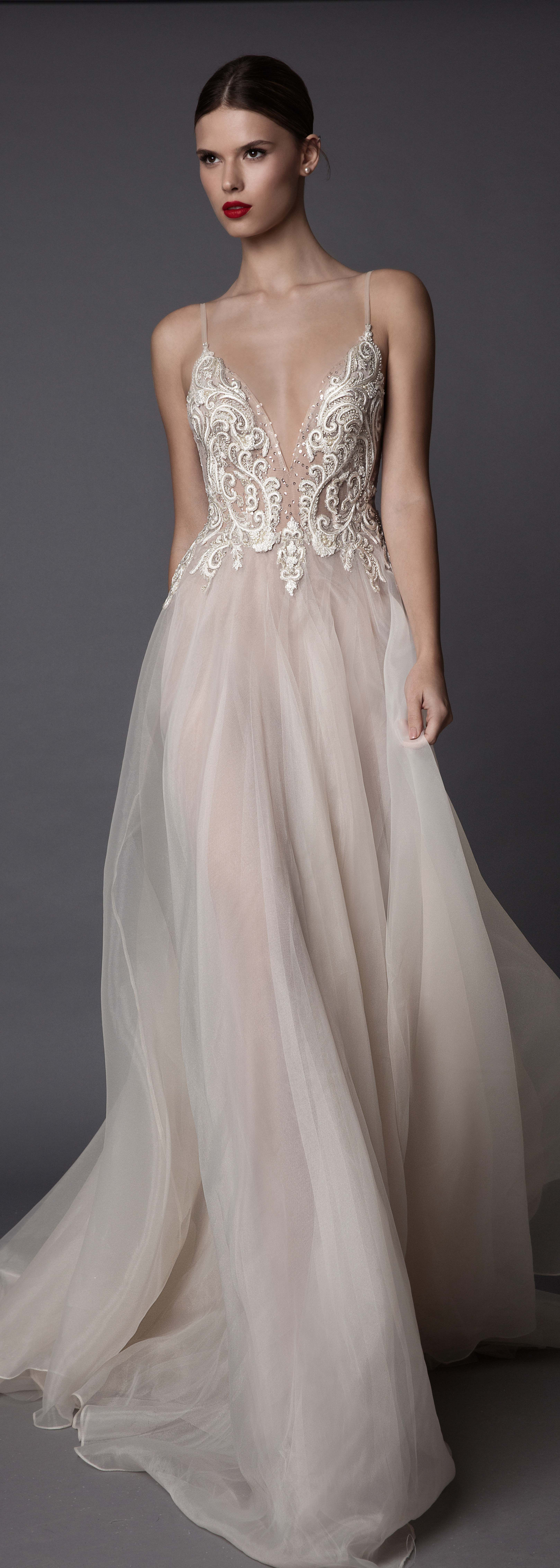 Low cut wedding dresses  Too low cut for a wedding but pretty  You would think Ium getting