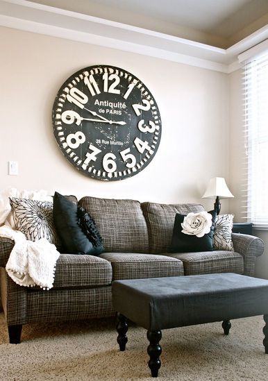 Decorating Ideas With A Large Clock In A Living Room Above The Couch With  High Contrast Decor