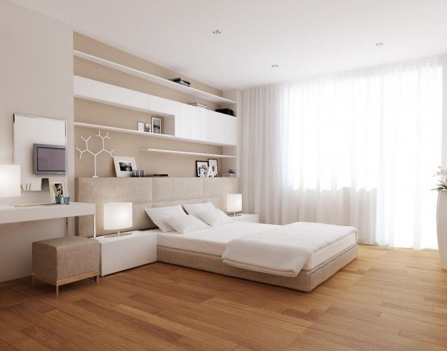 Modern Master Bedroom With White Low Profile Bed Beige Ottoman Two Floor Lamp And Clean White