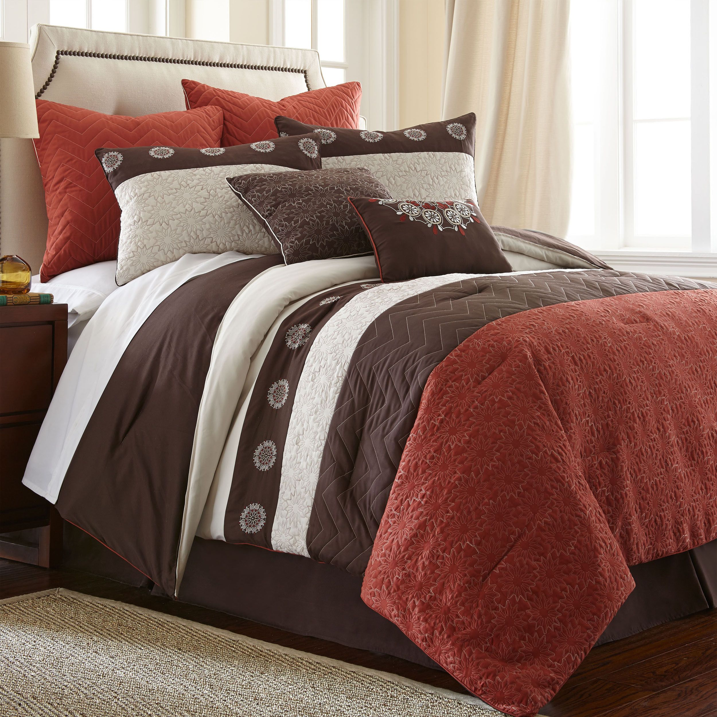 This elegant quilt set is crafted of 100 percent polyester for comfort and convenience. The three decorative pillows complete the look.