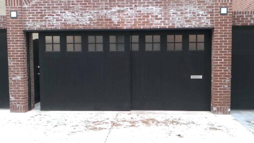 Decorations Black Side Sliding Garage Doors On Bricked Wall House Side Sliding Garage Doors The Coolest Sliding Garage Doors Garage Doors Garage Door Styles