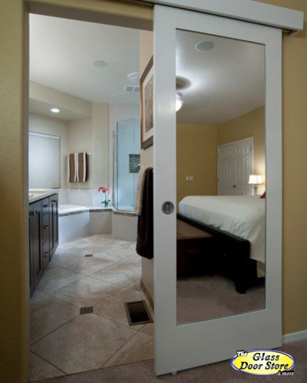 Barn door to master bathroom with mirror on both sides for Master bathroom entrance