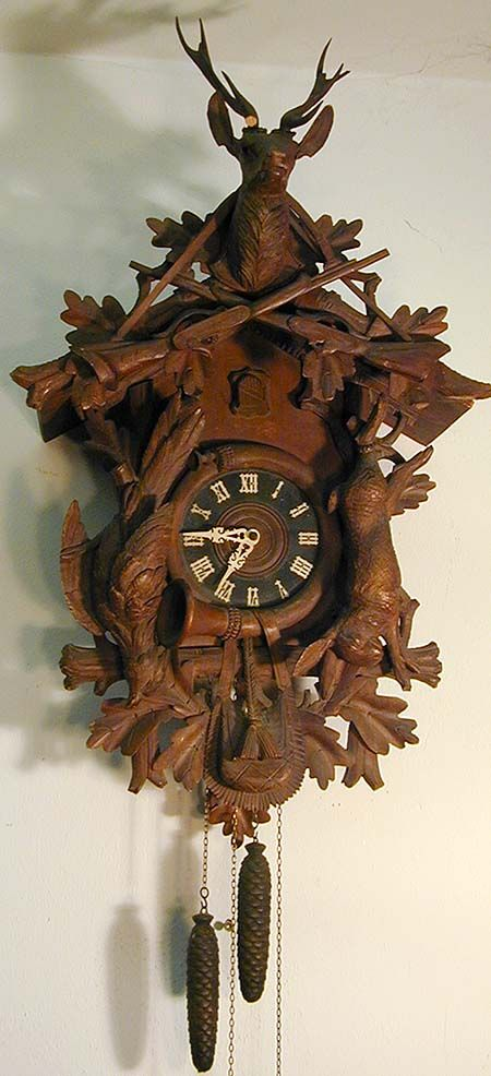 A Large Black Forest Carved Wood Cuckoo Clock With Stag