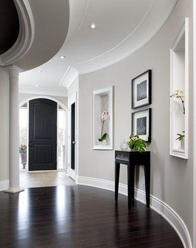 Gray walls, white trim, dark hardwood floors, Black ...