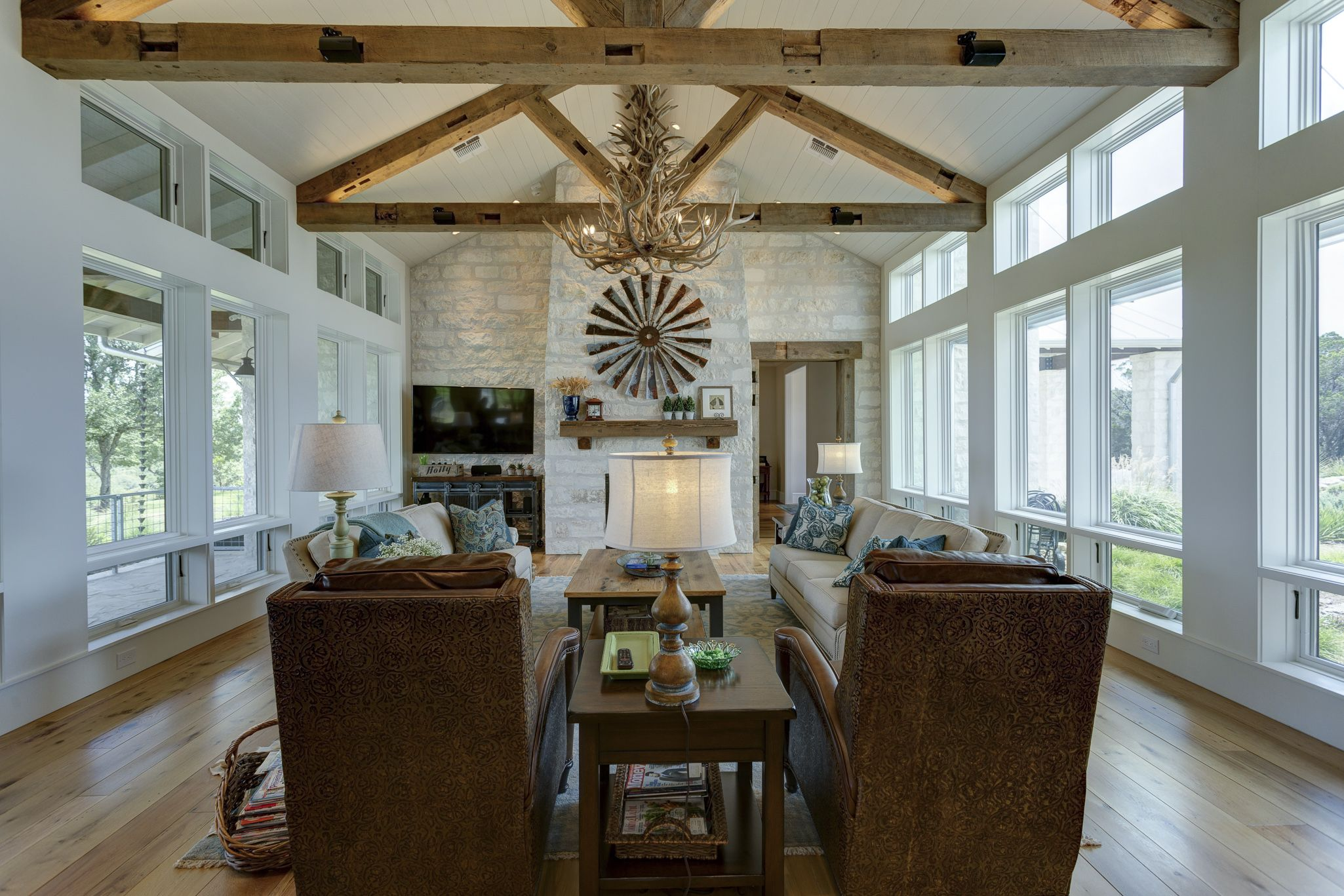 Family Room With Timber Roof Trusses And Painted Wood Ceiling