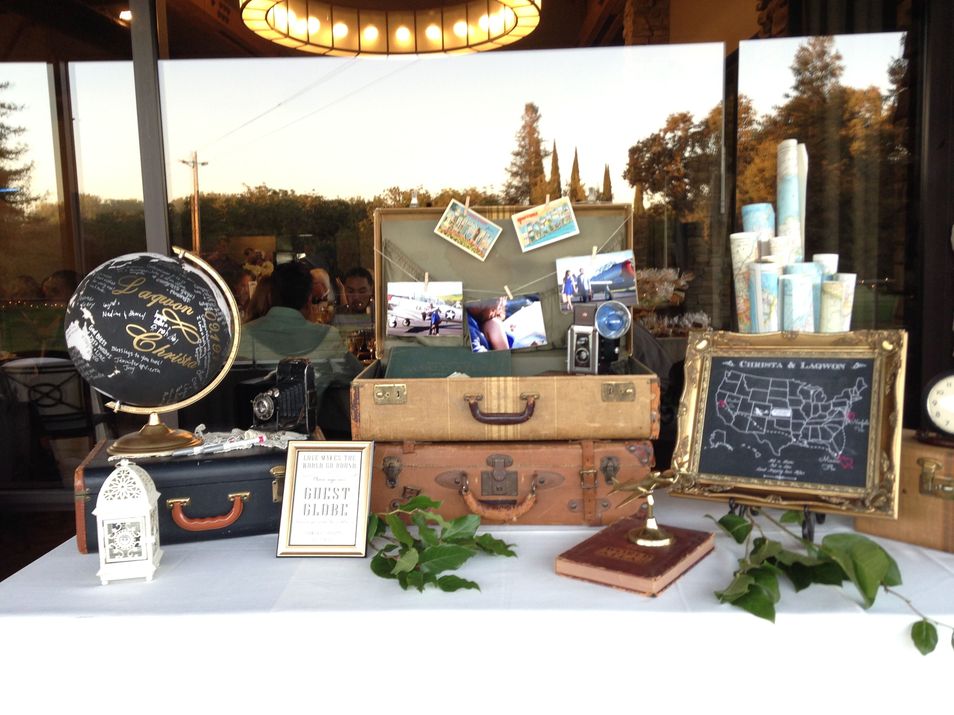 Vintage Travel Themed Guest Sign In Table With Vintage Suitcases