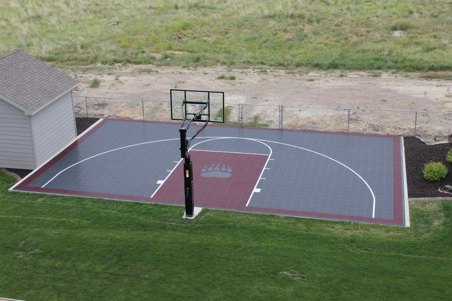 Outdoor 1 2 Court Basketball Featuring Grizzly Colors And Logo Www Fullcourtathletics C Outdoor Basketball Court Basketball Court Backyard Backyard Basketball