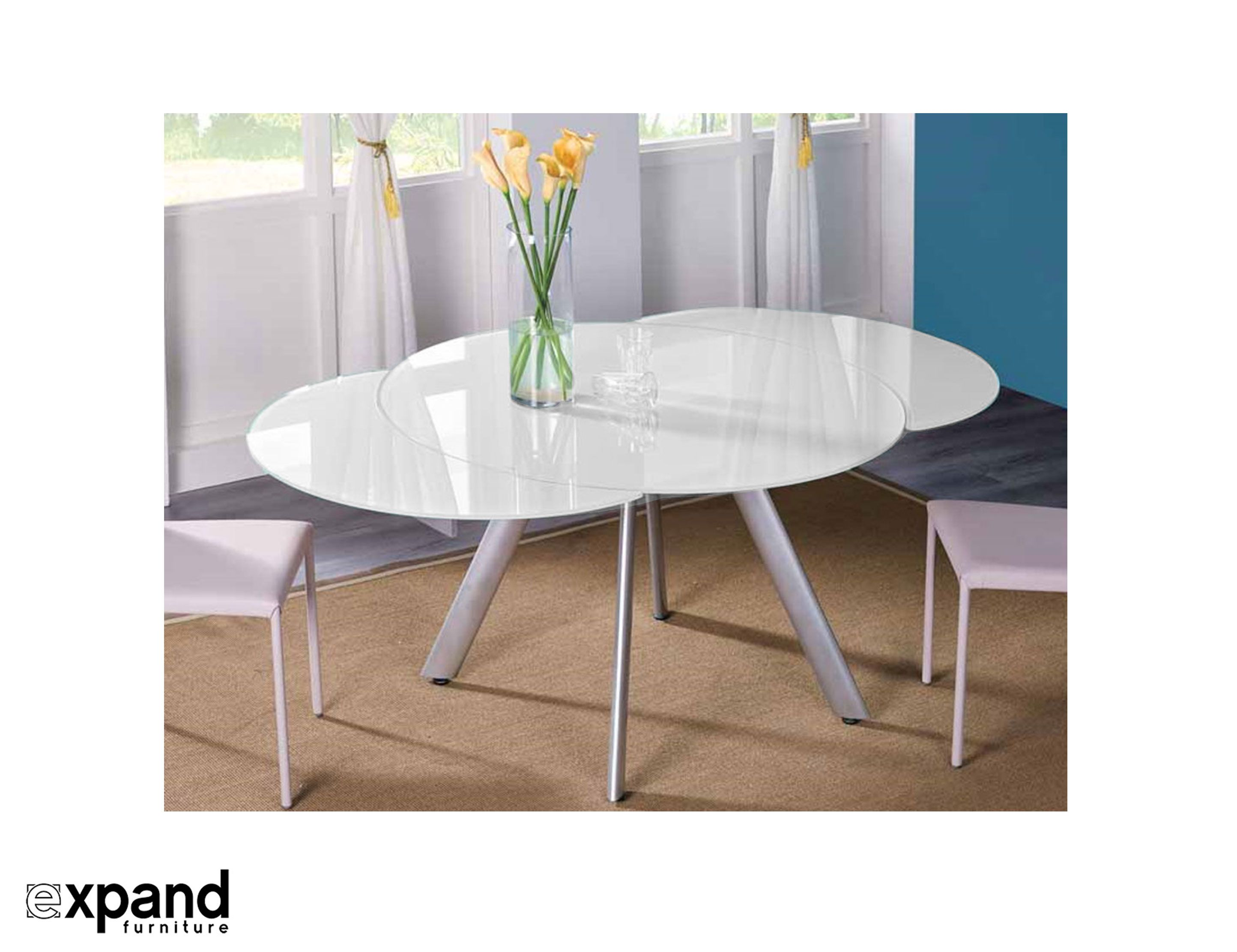 The Butterfly Expandable Round glass Dining Table extends its