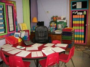 Desk behind small group table facing wall to save room...hmmm....maybe:)  Classroomready 004