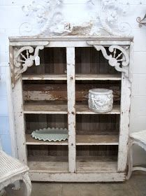 Painted cabinet looks like it was embellished with decorative porch trim.