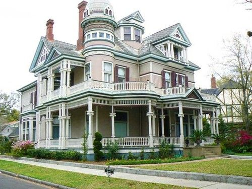 victorian house with semi wrap around porch and tower. Adore