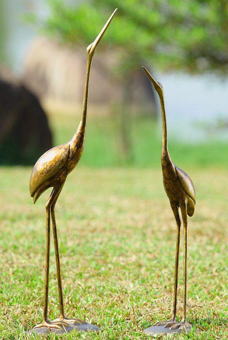 Crane Pair Garden Sculptures  A Tall Slender Pair Of Crane Sculptures That  Stand Separately On