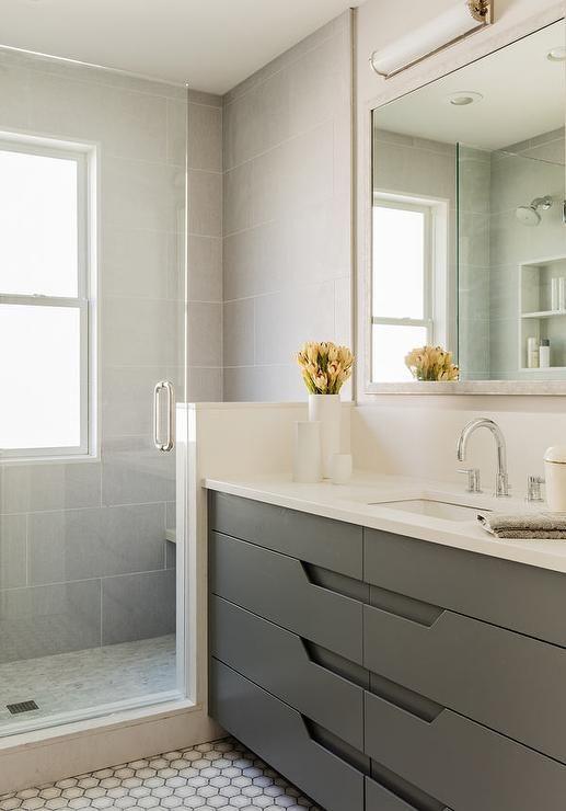 Modern gray bathroom features an ivory full length mirror for Grey floor length mirror