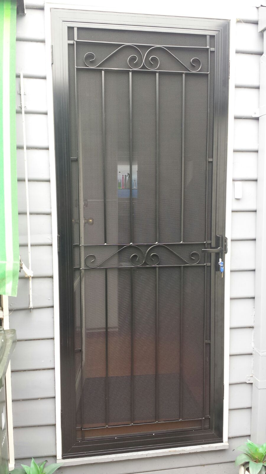Aluminium Frame Security Door With Steel Grille And Stainless Steel Mesh Installed In Mordialloc Metal Screen Doors Iron Door Design Steel Security Doors