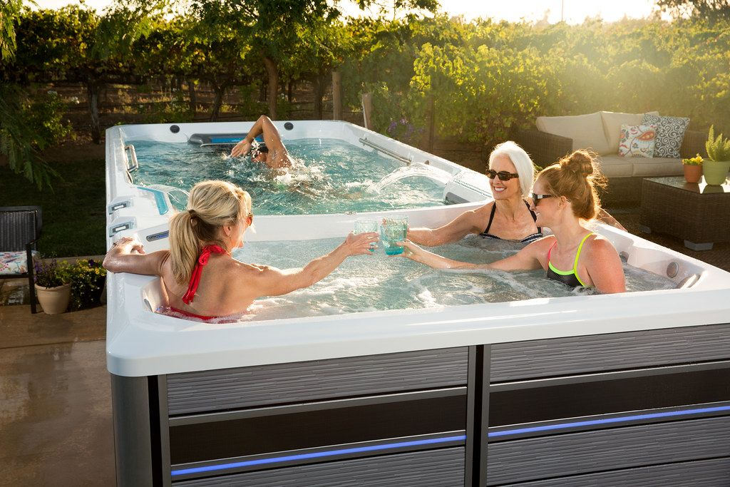 Swim Spas Vs Hot Tubs Which Should You Choose And Are They Worth It Endless Pool Swim Spa Swimming Pool Pictures