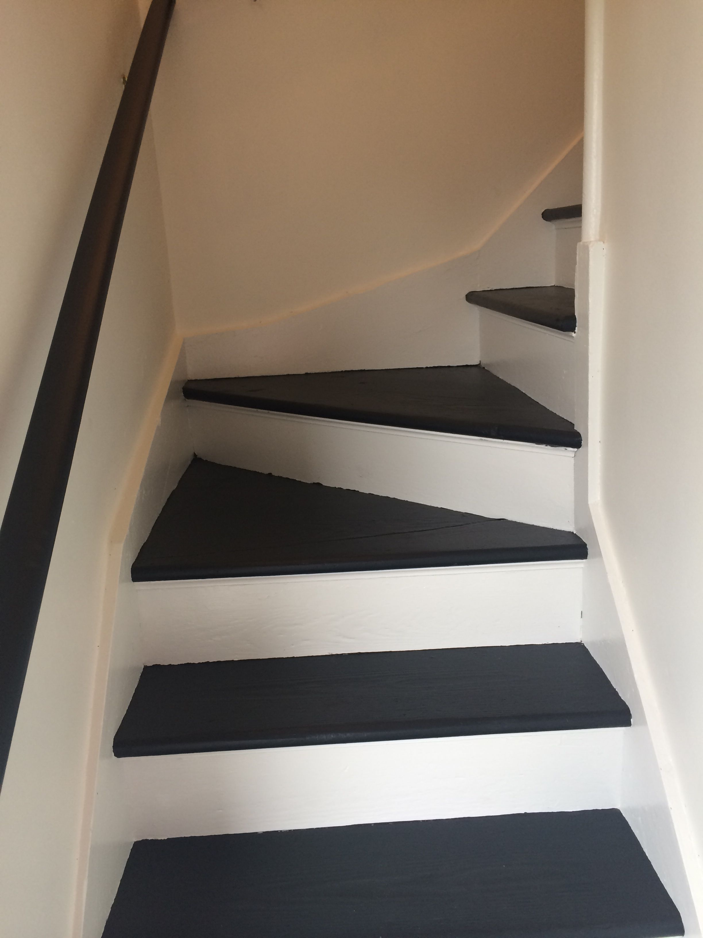 Back stairs AFTER. Swiss Coffee on walls, Low Luster Black on treads & banisters, White Dove on moldings and risers. (All colors from Benjamin Moore) So much light in this formally dark & dreary stairwell. #swisscoffeebenjaminmoore
