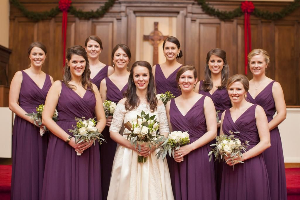 These girls wore full-length chiffon, purple bridesmaid dresses for Sarah's winter wedding. | A Romantic Winter-Themed Wedding
