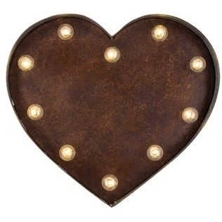 """Light your walls with interest and unique character. With ten LED bulbs, Metal Heart with LED Lights is the perfect way to give a rustic and warming touch to your home, business, or office.    It features an aluminum metal construction with rusted edges, a bronze background, and an easy-access on/off switch. Hang it up and let the light shine.        Dimensions:      Length: 15 3/8""""    Width: 14""""    Thickness: 2 3/8""""          Hanging Hardware:     ..."""