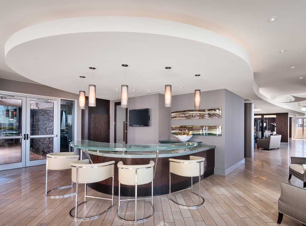 Dallas Design District Apartments host a dinner party in the resident clubroom at amli design