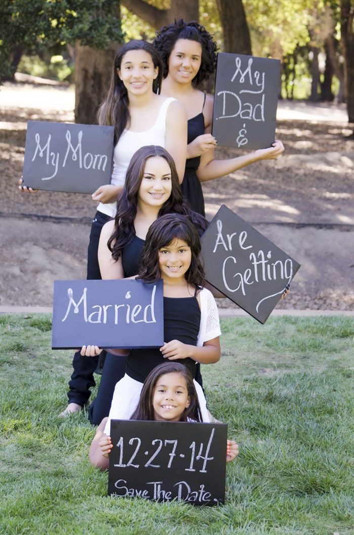 Cute Save-the-date portraits for a family blending.  There 5 girls all holding different chalk board with information for the save the date. See all the photos Jen Vazquez Photography http://jenvazquez.com