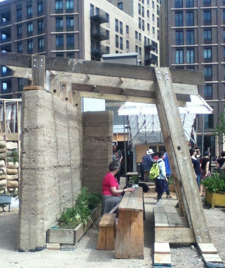 Pergola from reclaimed scaffolding boards Skip Garden