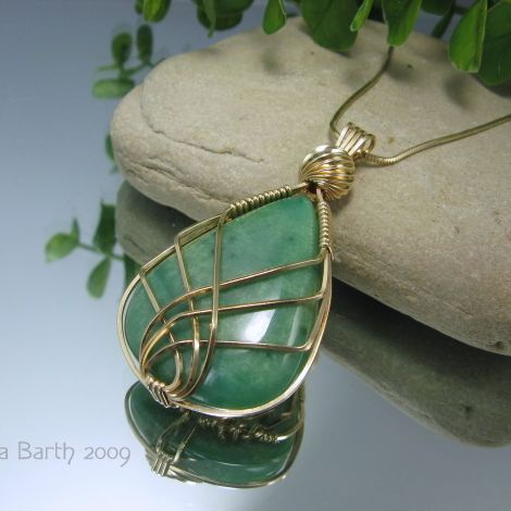 Criss cross wire wrapped pendant tutorial jewelrylessons criss cross wire wrapped pendant tutorial jewelrylessons several neat variations on website mozeypictures Choice Image
