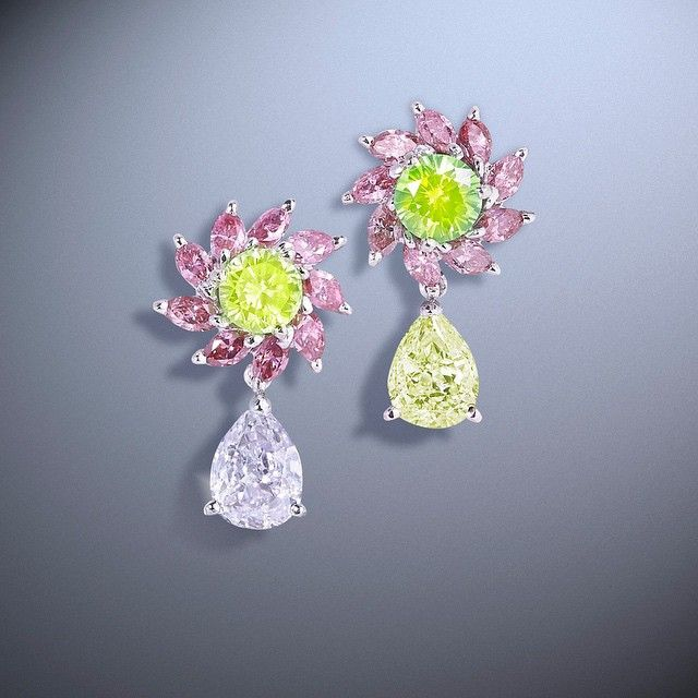 Moussaieff Jewellers. Rare beauty; brilliant, vivid green/yellow diamonds, fancy purplish pink and yellow pear earrings, set with pink diamond marquises