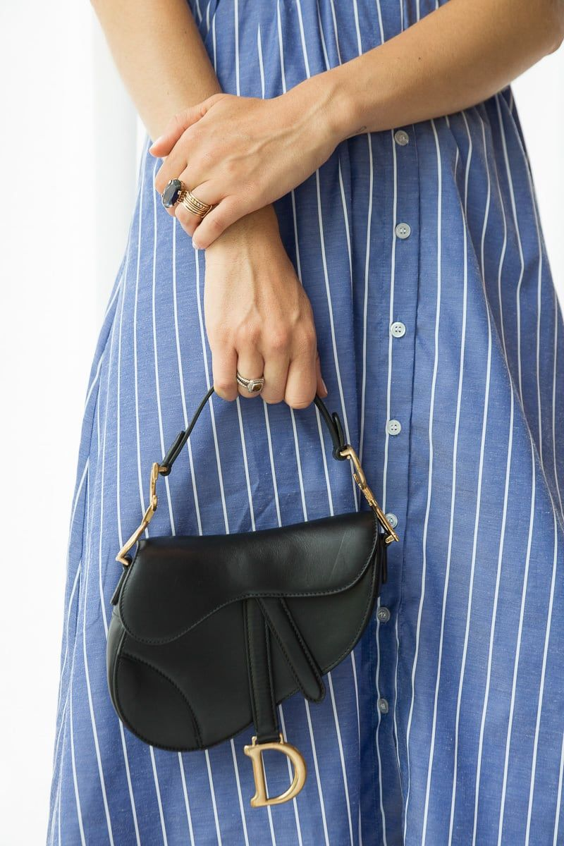 78b124a25 The Dior Saddle Bag is Officially Back in Stores dimensions of the medium saddle  bag in calfskin leather with aged, gold-tone accents are 10″ x 8″ x 2.6″,  ...