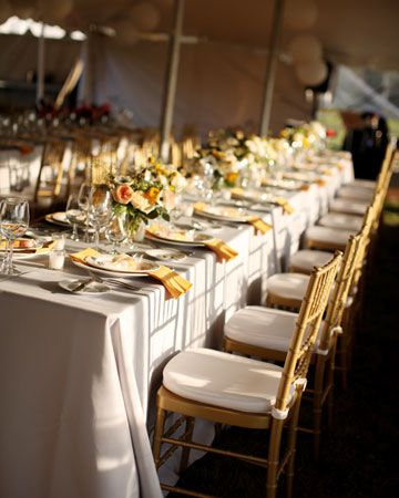 100 paper lanterns and 400 feet of cafe lights were hung above long tables decorated with golden yellow napkins and glass votives.