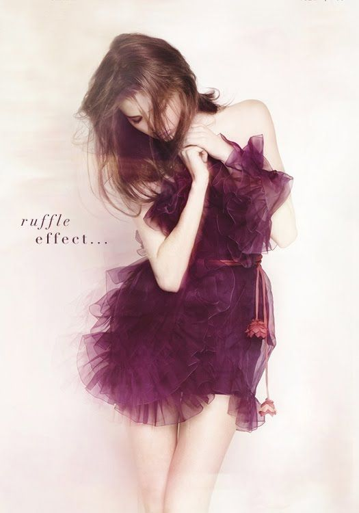Ruffly dress by Christian Dior...love the belt Fashion March 2011