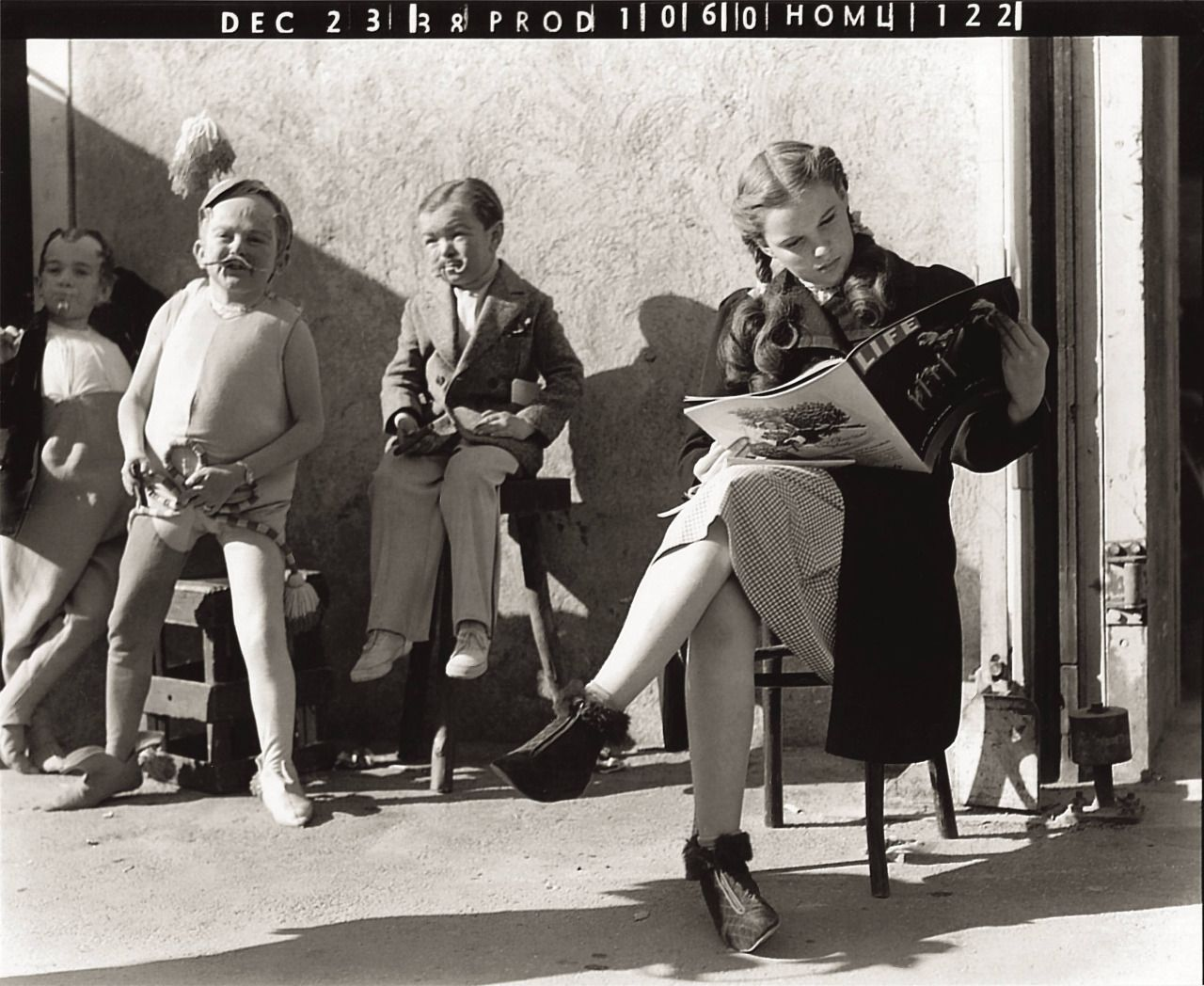Print of Judy Garland, Ray Bolger, Bert Lahr, and Jack