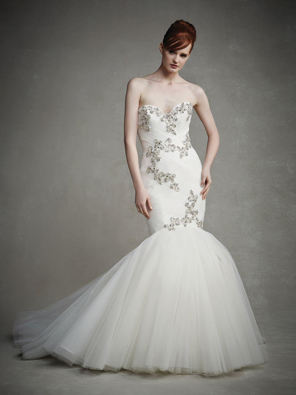 Tulle mermaid wedding dress  An ultrachic flare tulle mermaid skirt creates a beautiful