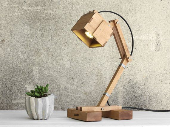 Kran Adjustable Wooden Lamp is part of Home Accessories Decor Lamps - This is not any normal desk lamp! This lamp has its own body and limbs and a genius brainy mind  You're able to play the Kran's arrangement and fix its arms, altering the height and direction of the light directly where you want it  guess, what's even more inspirational  You'll have fun figuring out how to correct it so that you can light up your desk, ceiling or wall